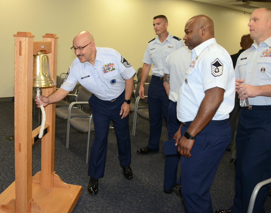 Senior Master Sgt. Randy Rodriguez, superintendent of the Air Force Recruiting Total Force Recruiting Cell, Joint Base San Antonio-Randolph, Texas, rings the bell signifying Air Force Recruiting Service reached their yearly goal. Each person at AFRS headquarters gets a turn ringing the bell celebrating making goal.(Air Force photo/Master Sgt. Chance Babin)