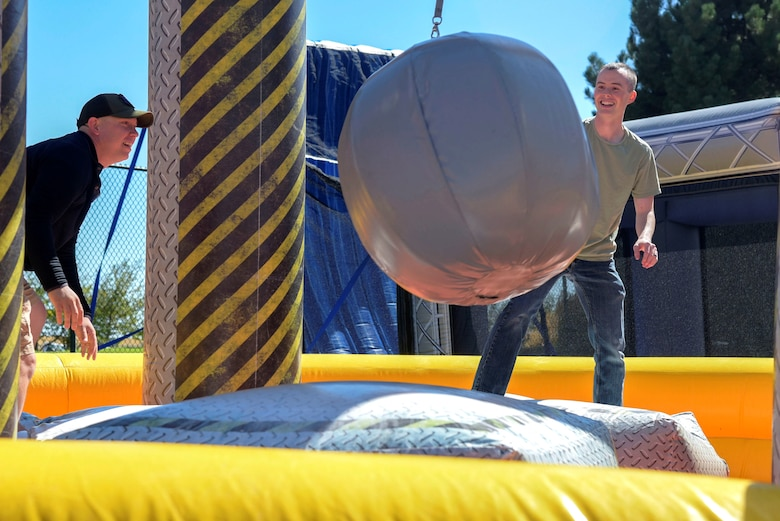 Master Sgt. Preston Brown, 460th Cyber Squadron operations support flight chief (left), 2nd Lieutenant Timothy Blondin, 460th Cyber Squadron operations flight commander (right), participate in a wrecking ball competition at the Team Buckley Connects Day on Sept. 27, 2019, Buckley Air Force Base, Colo.
