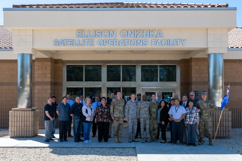 Leaders with the 50th Space Wing stop for a photo in front of Ellison Onizuka Satellite Operations Facility with 21st Space Operations Squadron Airmen at Vandenberg Air Force Base, California, Oct. 2, 2019. 21st SOPS is a geographically separated unit of the 50th SW that is responsible for safeguarding and observing satellite and launch operations. (U.S. Air Force photo by Maj. Ryan Harris)