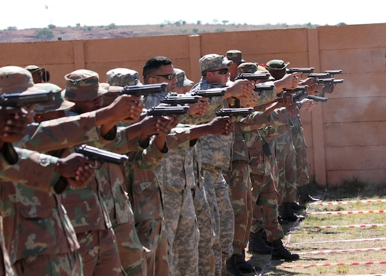 New York Army National Guardsmen from Company C, 2nd Battalion,108th Infantry, (Center) based in Gloversville, New York, join South African soldiers in a target shooting competition in Potchefstroom, South Africa, in November 2010. Ten New York National Guard Soldiers and Airmen will participate in the 2019 competition Oct. 21-26.