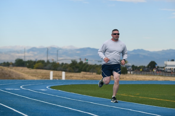 Senior Master Sgt. Kevin Ryan Jr., 11th Space Warning Squadron superintendent, runs his last lap of the one mile run at the track on Buckley Air Force Base, Colo.