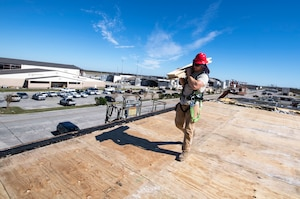 Civil engineers of the 823rd REDHORSE Squadron, Hurlburt Field, Fla., repair a roof at Tyndall Air Force Base just weeks after the Hurricane Michael, a category 5 storm, made landfall on Oct. 10, 2018.