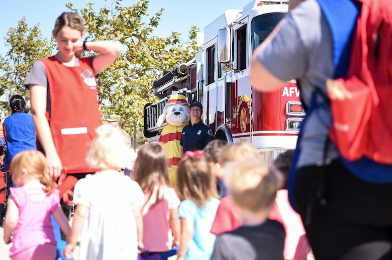 Sparky the fire dog greets children during Fire Prevention Week Oct. 7, 2019, at Vandenberg Air Force Base, Calif. Sparky, the mascot of the National Fire Protection Association, was created March 18, 1951, to convey important fire safety messages to children and adults. (U.S. Air Force photo by Airman 1st Class Hanah Abercrombie)