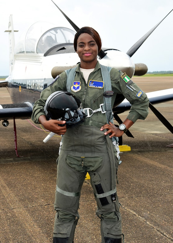 First Lt. Kafayat Sanni stands in front of a T-6 Texan II on Columbus Air Force Base, Miss. Sanni became the first female fighter pilot from the Nigerian air force, to graduate from the Aviation Leadership Program. ALP is a U.S. Air Force-funded program, providing students of friendly and developing countries with undergraduate pilot training scholarships. (Courtesy photo)