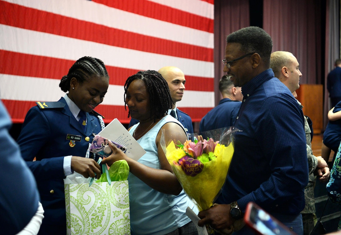 First Lt. Kafayat Sanni is congratulated by friends during a graduation ceremony Aug. 16, 2019, on Columbus Air Force Base, Miss. Sanni became the first female fighter pilot in the Nigerian air force upon graduating from the Aviation Leadership Program. (U.S. Air Force photo by Airman 1st Class Hannah Bean)