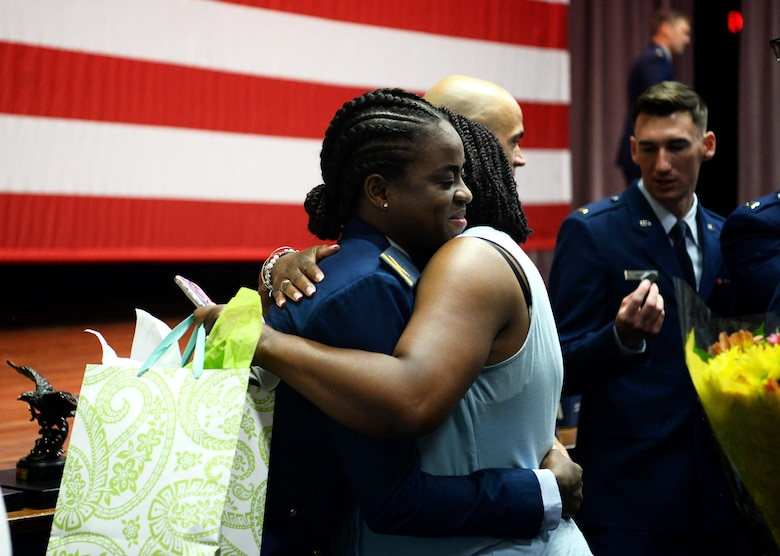 Col. Samantha Weeks, 14th Flying Training Wing commander, pins on 1st Lt. Kafayat Sanni's silver wings during a graduation ceremony Aug. 16, 2019, on Columbus Air Force Base, Miss. Sanni became the first female fighter pilot in the Nigerian air force upon graduating from the Aviation Leadership Program. (U.S. Air Force photo by Airman Davis Donaldson)