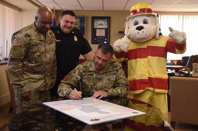 Col. Anthony Mastalir, 30th Space Wing commander, signs the Fire Prevention 30th Space Wing Commanders Proclamation Oct. 7, 2019, at Vandenberg Air Force Base, Calif. The proclamation is signed annually as a start to Fire Prevention Week and the first presidential proclamation for this week was made in 1925. (U.S. Air Force photo by Airman 1st Class Hanah Abercrombie)