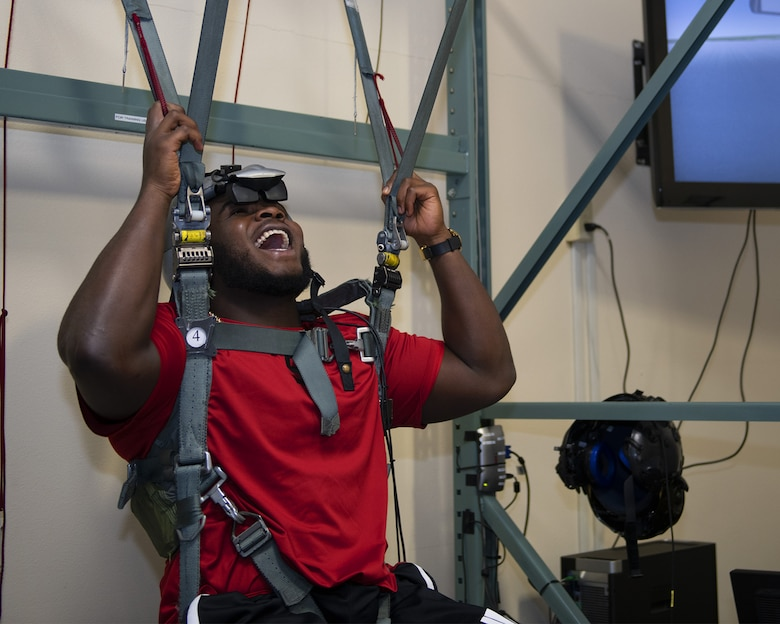 Grady Jarrett, Atlanta Falcons defensive tackle, experiences a parachute simulator at the Aircrew Flight Equipment facility Oct. 8, 2019, at Luke Air Force Base, Ariz.