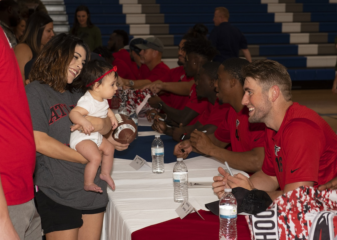 Danny Etling, Atlanta Falcons quarterback, converses with fans during a team meet-and-greet at the Bryant Fitness Center, Oct. 8, 2019, at Luke Air Force Base, Ariz.