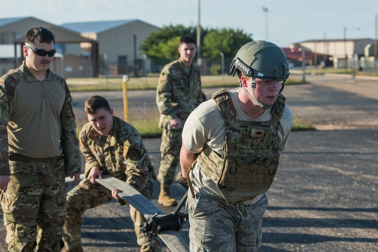 Airman 1st Class Kyle Fabrizius, 27th Special Operations Logistics Readiness Squadron fuels distribution technician, drags a roller across a fuel tube to empty it during the Forward Air Refueling Point tryouts at Cannon Air Force Base, N.M., October 9, 2019. During the tryouts, members do a physical test first and then are interviewed by the current FARP team. (U.S. Air Force photo by Senior Airman Vernon R. Walter III)
