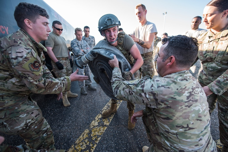 Airman 1st Class Caleb McDonald, 27th Special Operations Logistics Readiness Squadron fuels operator, lifts a fuel hose at the Forward Air Refueling Point tryouts at Cannon Air Force Base, N.M., October 9, 2019. During the tryouts, members do a physical test first and then are interviewed by the current FARP team. (U.S. Air Force photo by Senior Airman Vernon R. Walter III)