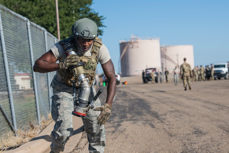 Senior Airman Demar Johnson, 27th Special Operations Logistics Readiness Squadron fuels service journeyman, drags a 300 foot fuel hose during the Forward Air Refueling Point tryouts at Cannon Air Force Base, N.M., October 9, 2019. The FARP team is composed of nine members and are currently aiming to grow to a unit of 12. (U.S. Air Force photo by Senior Airman Vernon R. Walter III)
