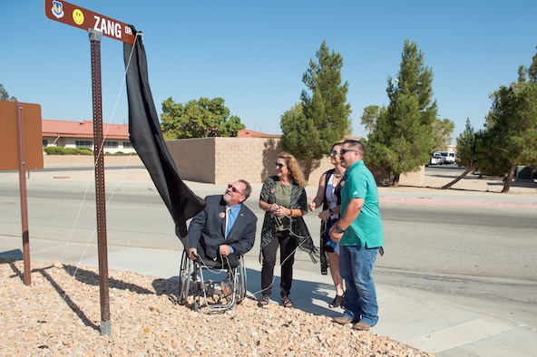 Dan Osburn, 412th Test Wing Technical Director, and members of the Zang family unveil the newly-dedicated Zang Drive road sign during a ceremony at Edwards Air Force Base, Oct. 9. The road was renamed in honor of Patrick Zang, an Edwards test engineer who passed away last year. Zang's career spanned more than 30 years and is the first Air Force civilian to have a road dedicated in his memory. (U.S. Air Force photo by Richard Gonzales)
