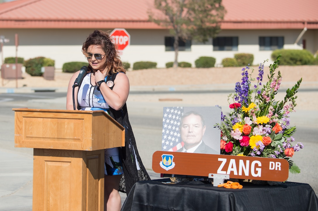 Patrick Zang's daughter, Susie, talks about her late father during a road dedication ceremony at Edwards Air Force Base, California, Oct. 9. Zang Drive was renamed in honor of Patrick Zang, an Edwards test engineer who passed away last year. Zang's career spanned more than 30 years and is the first Air Force civilian to have a road dedicated in his memory on the base. (U.S. Air Force photo by Richard Gonzales)