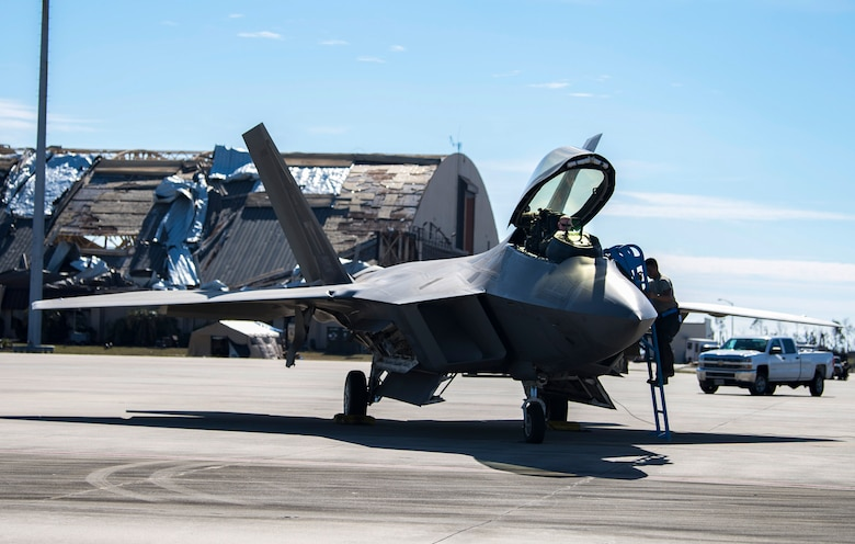 A pilot from the 27th fighter Squadron, Langley, Virginia, prepares to fly an F-22 Raptor fighter aircraft from Tyndall Air Force Base, Florida, following Hurricane Michael, October 24, 2018. Support personnel from Tyndall and other bases are working to repair base infrastructure and build bare-bones facilities after Hurricane Michael.(U.S. Air Force photo by Airman 1st Class Kelly Walker)
