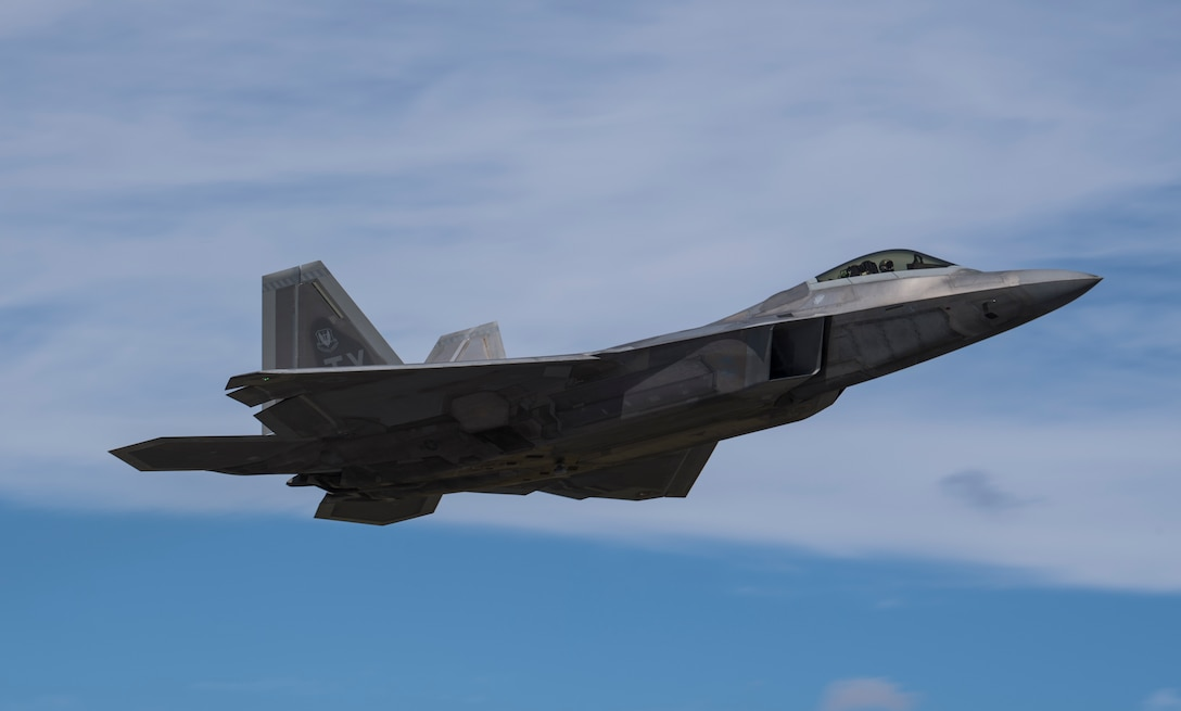 A Pilot from the 27th Fighter Wing, Joint Base Langly-Eustis, Virginia, flies an F-22 Raptor out of  Tyndall Air Force Base, Florida, Oct. 21, 2018, following the aftermath of Hurricane Michael. Multiple major commands have mobilized relief assets in an effort to restore operations after the hurricane caused catastrophic damage to the base. (U.S. Air Force photo by Senior Airman Keifer Bowes)