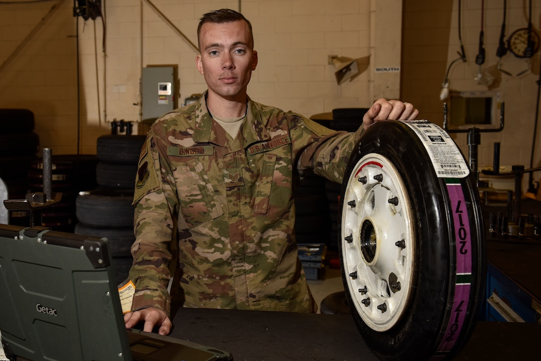 Staff Sgt. Kyle Dinger, 325th Aircraft Maintenance Squadron crew chief, poses for a portrait in the wheel and tire section at Tyndall Air Force Base, Fla. March 6, 2019.(U.S. Air Force photo by Staff Sgt. Alexandre Montes)