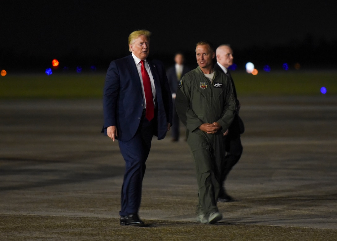 U.S. Air Force Col. Brian Laidlaw, 325th Fighter Wing commander, walks with President Donald J. Trump, after a flightline tour at Tyndall Air Force Base, Florida, May 8, 2019. Tyndall AFB leaders and civic leaders met with Trump to provide an update on base recovery efforts. (U.S. Air Force photo by Airman 1st Class Monica Roybal)