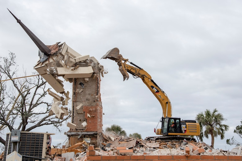A construction crew demolishes the steeple at Chapel 2 at Tyndall Air Force Base, Fla. Feb. 15, 2019.