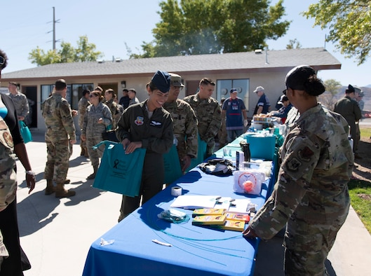 Airmen learn about the resources offered at the opening of the new Sexual Assault Prevention and Response Office, at Creech Air Force Base, Nevada, Sept. 30, 2019. One of the many other benefits of Creech having its own SAPR Office is that Airmen, contractors, and adult dependents won't have to drive the hour-long commute to the Nellis AFB location. (U.S. Air Force photo by Senior Airman Lauren Silverthorne)