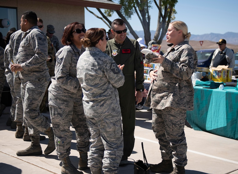 Personnel share lunch at the new Sexual Assault Prevention and Response Office opening at Creech Air Force Base, Nevada, Sept. 30, 2019. All of the same services provided at Nellis - victim advocates, referrals to mental health, counseling, medical care, special victims counsel and more are now available at Creech. (U.S. Air Force photo by Senior Airman Lauren Silverthorne)