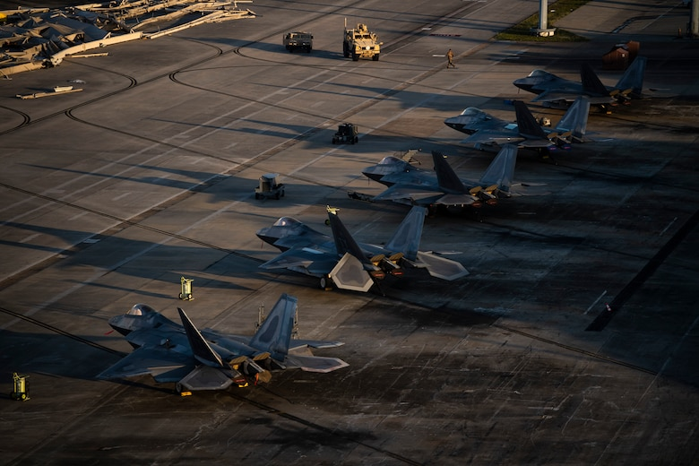 F-22 Raptors are parked near the runway at Tyndall Air Force Base, Florida, Oct. 15, 2018. Air Combat Command has mobilized multiple relief assets in an effort to restore operations after the hurricane caused catastrophic damage to the base. (U.S. Air Force photo by Master Sgt. Russ Scalf)