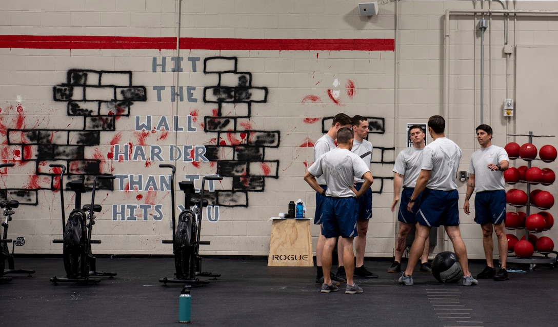 The 20th Civil Engineer Squadron, Explosive Ordnance Disposal (EOD) flight Airmen gather for a team pep-talk as they train for the new Tier 2 physical fitness test at Shaw Air Force Base, South Carolina, Oct. 4, 2019.