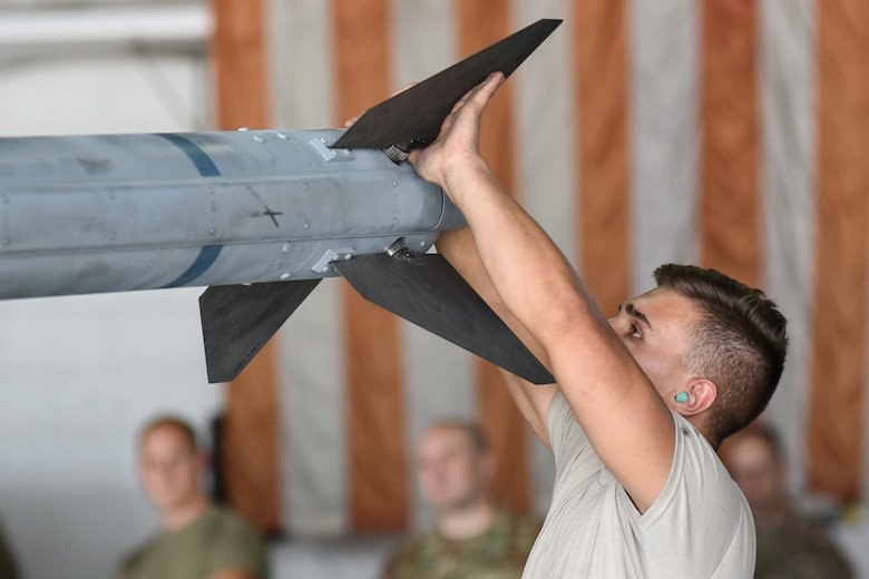U.S. Air Force Airman 1st Class Tylan Armstrong, 55th Aircraft Maintenance Unit (AMU) load crew member, examines fins for a munition during the quarterly load crew competition at Shaw Air Force Base, South Carolina, Oct. 7, 2019.
