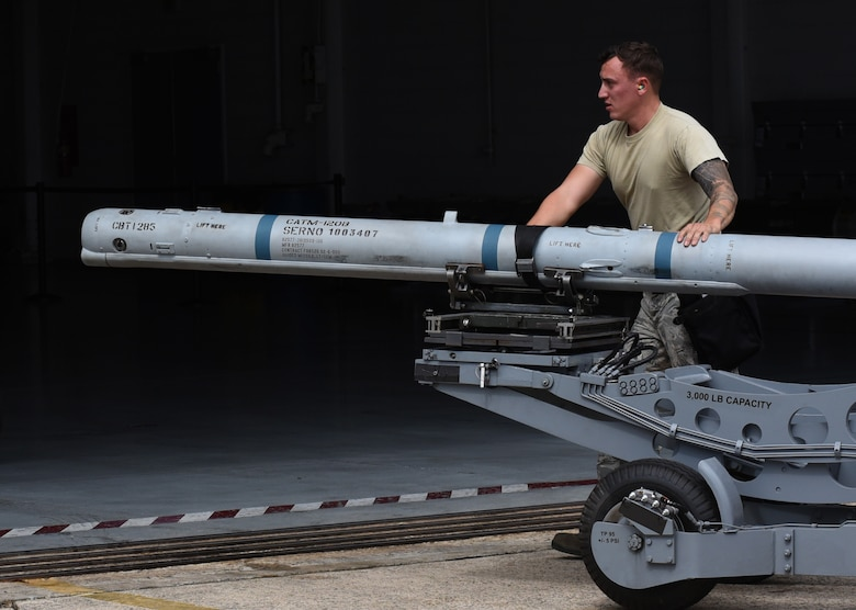 U.S. Air Force Staff Sgt. Christopher Whitten 79th Aircraft Maintenance Unit (AMU) load crew member helps guide munitions into the hanger during a quarterly load crew competition at Shaw Air Force Base, South Carolina, Oct. 7, 2019.