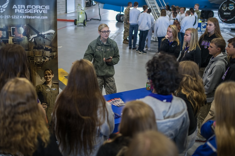 Staff Sgt. Jennifer Deimund, Air Force Reserve Recruiting, shares information about the Air Force Reserves to area high school students during the JROTC Day event at at Scott Air Force Base, Illinois, Oct. 8, 2019. More than 400 high school students from 11 schools across Missouri and Illinois learned about various careers in the Air Force. (U.S. Air Force photo by Christopher Parr)