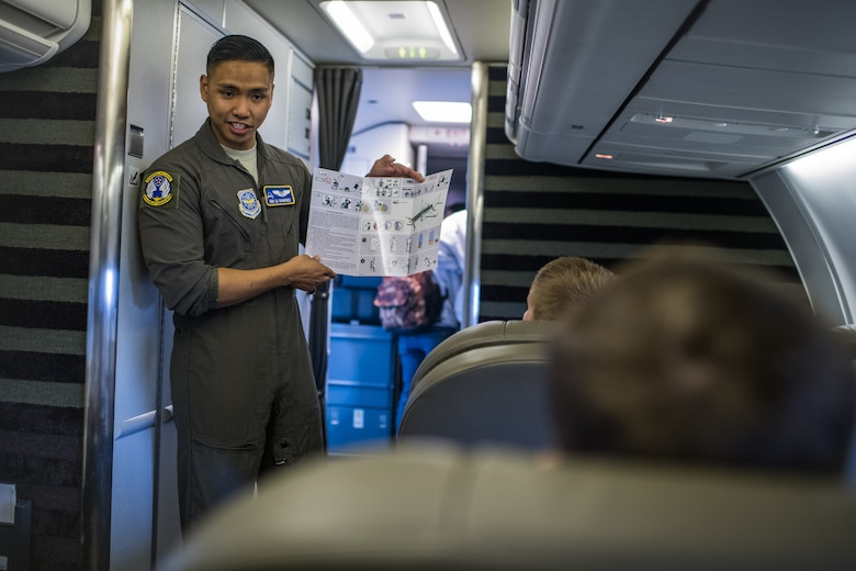 Senior Airman DJ Ramones, 54th Airlift Squadron executive flight attendant, gives a briefing to area high school students about duties of an executive flight attendant and provides a tour of a C-40C during the JROTC Day event at at Scott Air Force Base, Illinois, Oct. 8, 2019. More than 400 high school students from 11 schools across Missouri and Illinois learned about various careers in the Air Force. (U.S. Air Force photo by Christopher Parr)