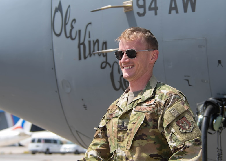 1st Lt. Mike Jolly, a 700th Airlift Squadron pilot, smiles as he steps off the C-130H3 he piloted for Exercise Eager Lion in Jordan on Sept. 1, 2019. Exercise Eager Lion is a multi-national exercise where Dobbins Air Reserve Base is the primary provider of air support. (U.S. Air Force photo by Senior Airman Josh Kincaid)