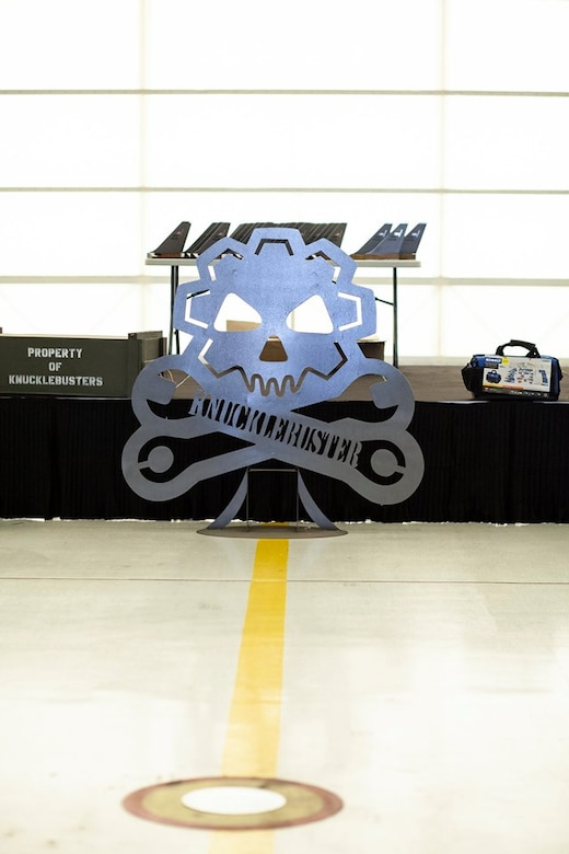 The Knucklebuster insignia stands in front of the stage at the Knucklebuster's Award Ceremony Oct. 5, 2019, at McConnell Air Force Base, Kan. The banquet is held annually to recognize maintainers who have significantly impacted their squadron's mission. (U.S. Air Force photo by 2nd Lt. Kaitlyn Danner)