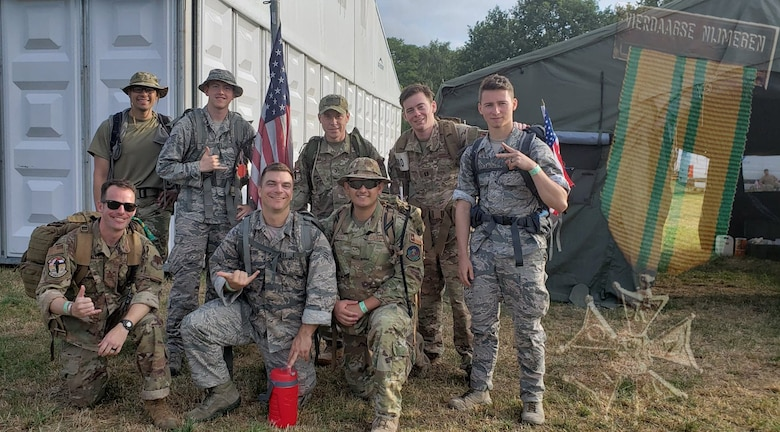 U.S. Air Force Airmen with the 693nd Intelligence, Surveillance and Reconnaissance Group at Ramstein Air Base, Germany, complete the Vierdaagse march in Nijmegen, Netherlands, July 16-19, 2019. Each of the eight Airmen carried 22 pounds for 100 miles over a 4-day period. The overlay is of the Vierdaagsekruis, or Four Days Cross medal, which was presented to participants by the Dutch government. (Courtesy photo illustration)