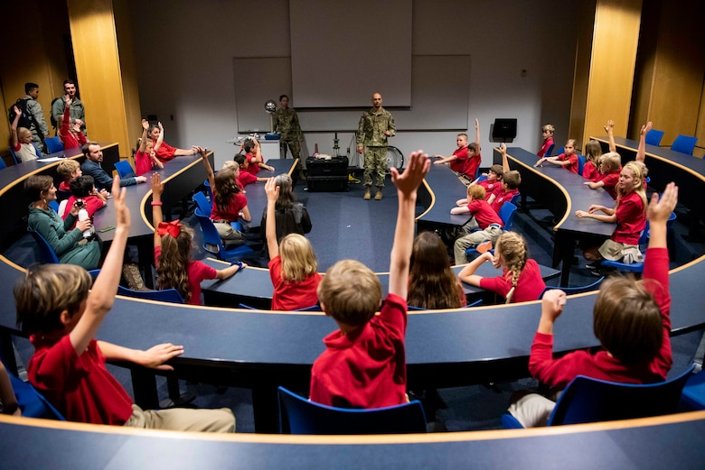 "U.S. AIR FORCE ACADEMY, Colo. -- A group of local school children take part in ""Audience with an Astronaut"" at the Air Force Academy, Oct. 9, 2019. The event highlighted the importance of science, engineering, technology and math education as well as the role of the space industry.  (U.S. Air Force photo/Joshua Armstrong)"