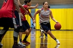 Air Force Staff Sgt. Cinnamon Kava dribbles past defenders during the U.S. armed forces women's basketball team's scrimmage at Fort Indiantown Gap, Pa., Oct. 3, 2019. The team held practices in preparation for the Military World Games scheduled to take place in China, Oct. 18-28.
