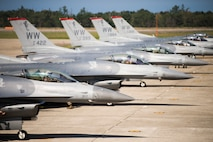 Six U.S. Air Force F-16 Fighting Falcons sit on the flight line during an aviation training relocation at Komatsu Air Base, Japan, Oct. 1, 2019. The pilots spent four days conducting within visual range air-to-air combat training with Japan Air Self-Defense Force pilots increasing tactical strength, friendship and their alliance. (U.S. Air Force photo by Senior Airman Collette Brooks)