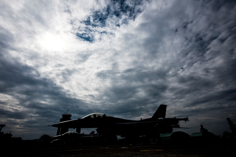 A U.S. Air Force F-16 Fighting Falcon sits on the Komatsu flight line during the 2019 Komatsu aviation training relocation at Komatsu Air Base, Japan, Oct. 2, 2019. The ATR gave 13th Fighter Squadron pilots an opportunity to work alongside their host nation counterparts, Japan Air Self-Defense Force, during the 28 within visual range air-to-air sorties. (U.S. Air Force photo by Senior Airman Collette Brooks)