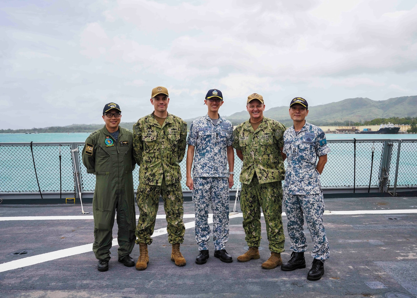 NAVAL BASE GUAM (Oct. 8, 2019) U.S. and Republic of Singapore Navy (RSN) leaders pose for a photo on the flight deck of RSN frigate RSS Formidable (FFS 68) following a visit and tour of the ship in support of Pacific Griffin 2019. Pacific Griffin is a biennial exercise conducted in the waters near Guam aimed at enhancing combined proficiency at sea while strengthening relationships between the U.S. and Republic of Singapore navies.