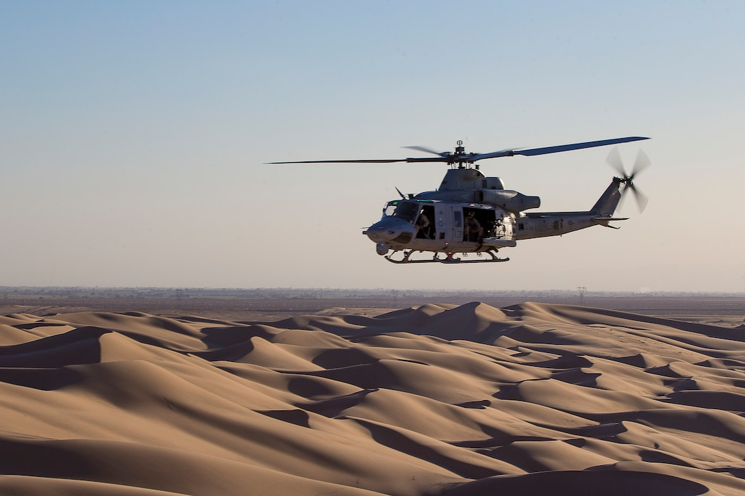 A U.S. Marine Corps UH-1Y Venom aircraft assigned to Marine Aviation Weapons and Tactics Squadron One conducts a simulated urban close air support exercise during Weapons and Tactics Instructor course 1-20 in Brawley, California, Oct. 3, 2019. WTI is a seven-week training event hosted by MAWTS-1, which emphasizes operational integration of the six functions of Marine Corps aviation in support of a Marine Air Ground Task Force. WTI also provides standardized advanced tactical training and certification of unit instructor qualifications to support Marine aviation training and readiness, and assists in developing and employing aviation weapons and tactics.