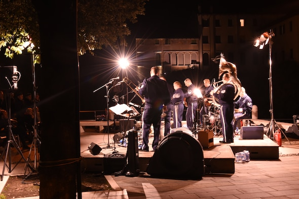 "U.S. Air Forces in Europe and Air Forces Africa band, Wings of Dixie, perform an evening concert for the community in Portogruaro, Italy, Oct. 4, 2019. The USAFE-AFAFRICA band showed the communities around Aviano Air Base they live up to their motto as ""America's Musical Ambassadors"" of goodwill. (U.S. Air Force photo by Julie Scott)"