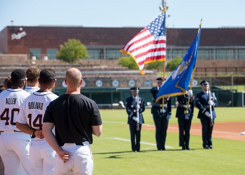 The Glendale Javelinas show respect to the U.S. flag as the Luke Air Force Base Honor Guard post the colors during the National Anthem at a Major League Baseball Arizona Fall League military appreciation game Oct. 6, 2019, at Camelback Ranch stadium in Phoenix.