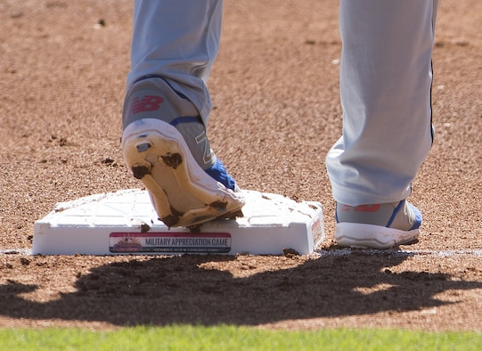 A Scottsdale Scorpion baseball player stands on third base during an Arizona Fall League military appreciation baseball game Oct. 6, 2019, at Camelback Ranch stadium in Phoenix.
