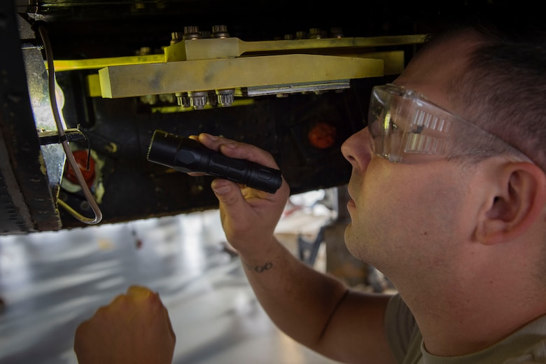 Airman 1st Class Stephen Weidig, 23d Maintenance Squadron (MXS) crew chief, examines a vibration absorber during an HH-60G Pave Hawk phase inspection Oct. 9, 2019, at Moody Air Force Base, Ga. The 23d MXG maintainers disassemble, inspect and repair the HH-60 after every 600 flight hours. These maintainers continually work to ensure the aircraft are safe and reliable for search and rescue missions. (U.S. Air Force photo by Airman Azaria E. Foster)