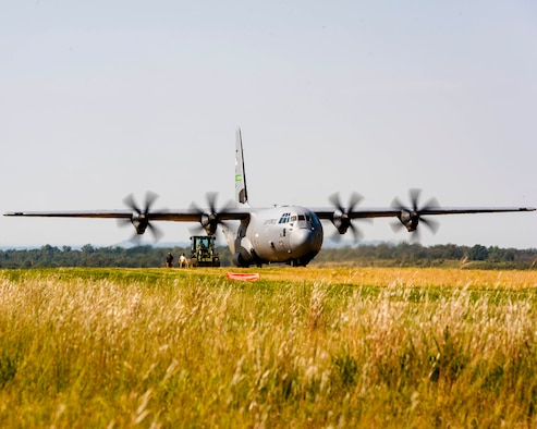 Air Force Reserve aerial transportation specialists approach a C-130J with a forklift to perform a combat offload method-B on a dirt landing zoneon Oct. 5, 2019, located on Fort Chaffee, Ark. Due to evolving combatant command requirements, the Air Force Reserves has increased focus on units operating effectively in degraded environments. (U.S. Air Force Reserve photo by Maj. Ashley Walker)
