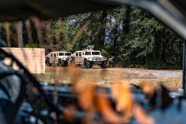 A Humvee convoy scans the area for potential threats during a field convoy operation Oct. 8, 2019, at Moody Air Force Base, Ga. The field convoy operation gave 23d Security Forces Squadron Airmen an opportunity to improve the ability to shoot, move and communicate, ensuring the Airmen are properly trained and prepared to carry out their mission in a contested environment. (U.S. Air Force photo by Airman 1st Class Taryn Butler)