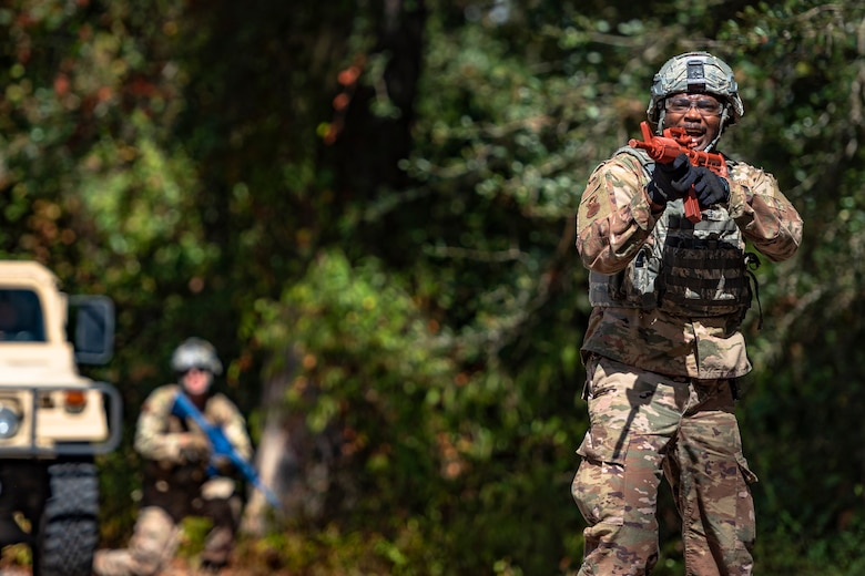 Staff Sgt. Terrance McLaurin, 23d Security Forces Squadron (SFS) installation patrolman, yells during a field convoy operation Oct. 8, 2019, at Moody Air Force Base, Ga. The field convoy operation gave 23d SFS Airmen an opportunity to improve the ability to shoot, move and communicate, ensuring the Airmen are properly trained and prepared to carry out their mission in a contested environment. (U.S. Air Force photo by Airman 1st Class Taryn Butler)