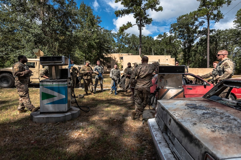 Airmen with the 23d Security Forces Squadron (SFS) conduct a debrief after a field convoy operation Oct. 8, 2019, at Moody Air Force Base, Ga. The field convoy operation gave 23d SFS Airmen an opportunity to improve the ability to shoot, move and communicate, ensuring the Airmen are properly trained and prepared to carry out their mission in a contested environment. (U.S. Air Force photo by Airman 1st Class Taryn Butler)