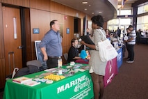 Jim Maher, director behavioral health department, Marine Corps Logistics Base Barstow, California, discusses services offered for base personnel by his office and what skill sets they look for in future employees, at the Career and Education Expo held at Barstow Community College, Oct. 3.