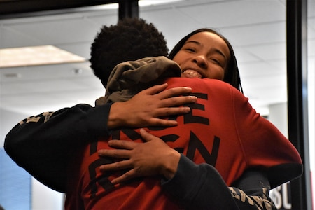 Marva Burns smiles as she hugs her son Marquis Butts after they both took the oath of enlistment, Oct. 8, Phoenix Military Entrance Processing Station. Both mother and son enlisted simultaneously in the U.S. Army. (U.S. Army Photo by Alun Thomas, Phoenix Recruiting Battalion Public Affairs)